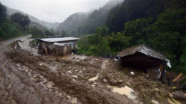 Photo of Landslide triggered by tropical rain kills 40 in Mexico