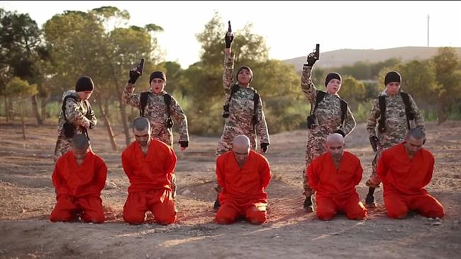 Photo of British boy among five children executing prisoners in Syria