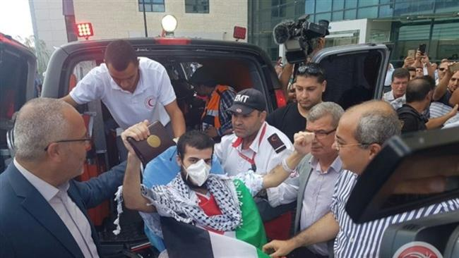 Photo of Palestinian hunger striker al-Qadi released, transfered to hospital