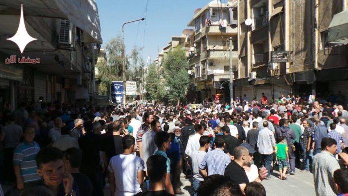 Photo of Massive protest against terrorist violence in Qudsiyah suburb of Damascus
