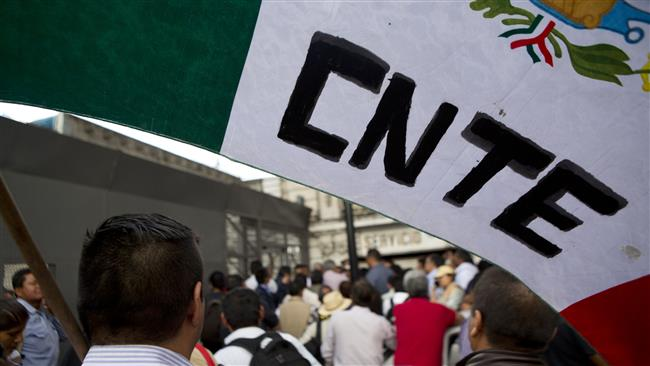Photo of Police clash with striking teachers in southern Mexico