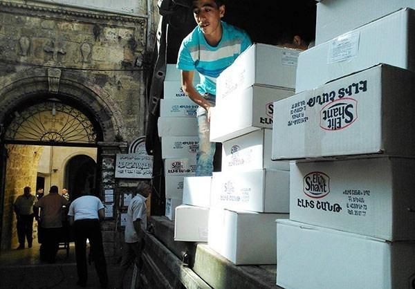 Photo of 40 Tons of Humanitarian Aid Distributed among People in Lattakia