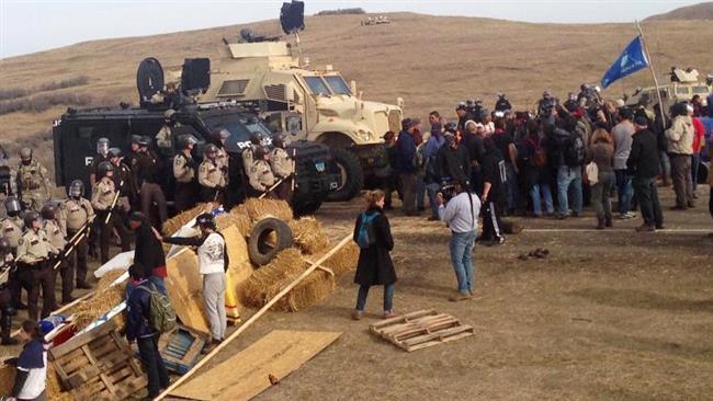 Photo of Police arrest over 140 in crackdown on North Dakota oil pipeline protesters