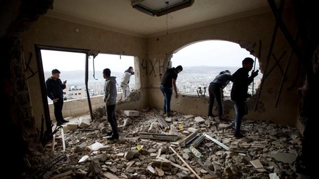 Photo of Rabid dog Israeli forces demolish three Palestinian homes in al-Quds