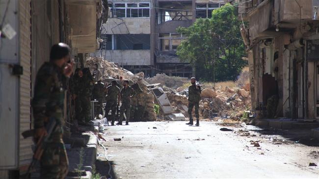Photo of Syrian army soldiers, allies recapture more districts in Aleppo