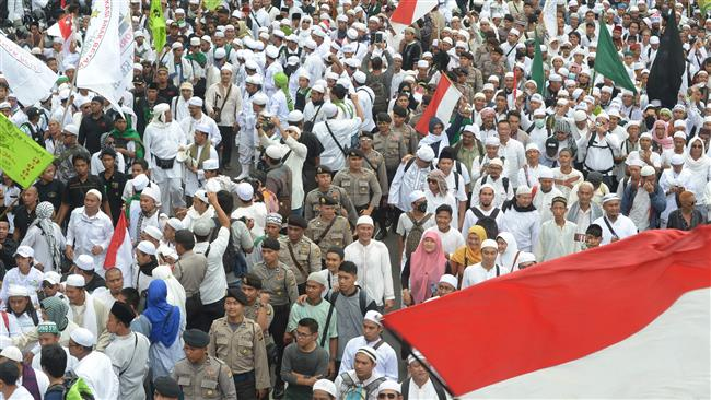 Photo of Massive protest urges dismissal of Jakarta governor in Indonesia