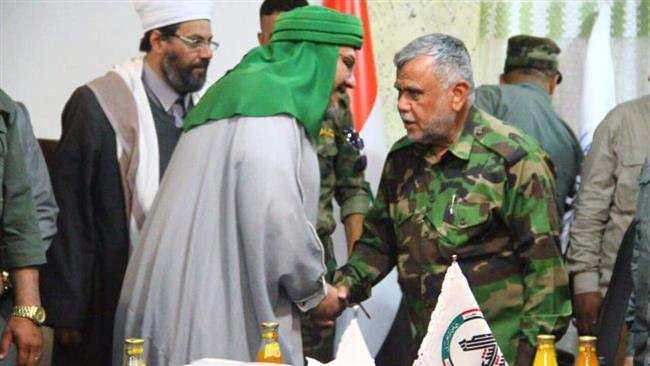 Photo of Iraq scholars hail parliament vote to legalize Hashd al-Sha'abi