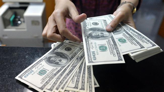 Photo of Iran tells banks to sell dollars at free rates