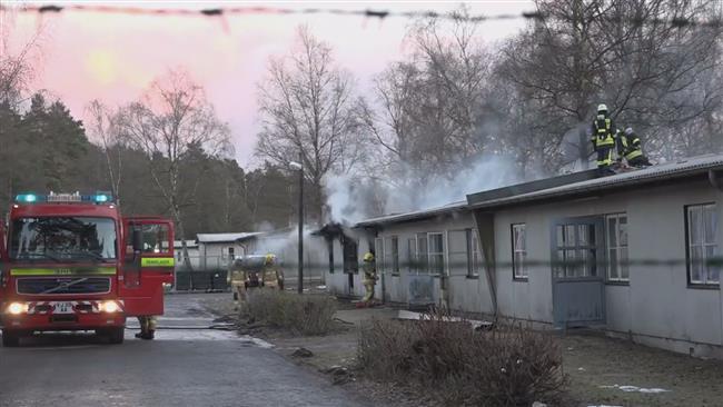 Photo of Fire injures dozens at German refugee shelter
