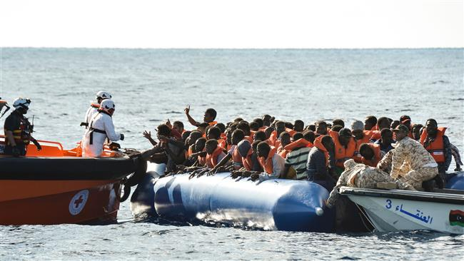 Photo of 1,300 rescued refugees arrive in Italy's Sicily