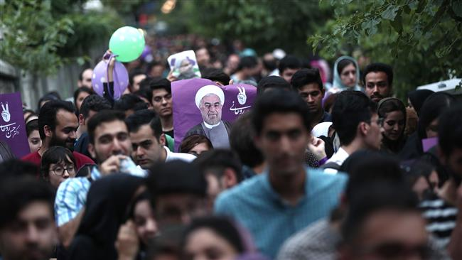 Photo of PHOTOS: Rouhani's supporters celebrate election victory