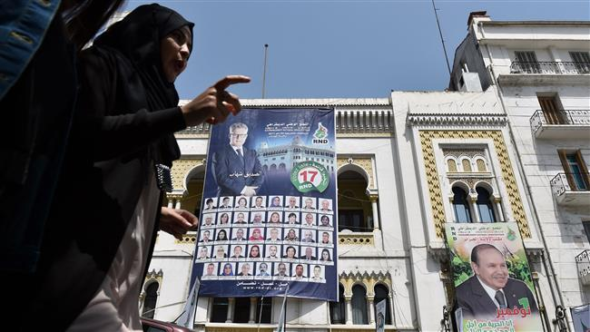 Photo of Algerians casting ballots in parliamentary elections