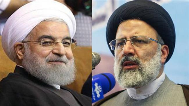 Photo of Rouhani, Raeisi in heated race to win over voters in Mashhad