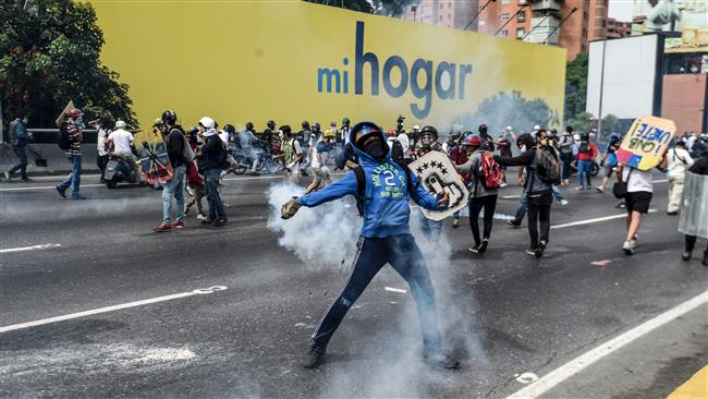 Photo of Satanic US plot Fresh protests rock Venezuela after man set on fire
