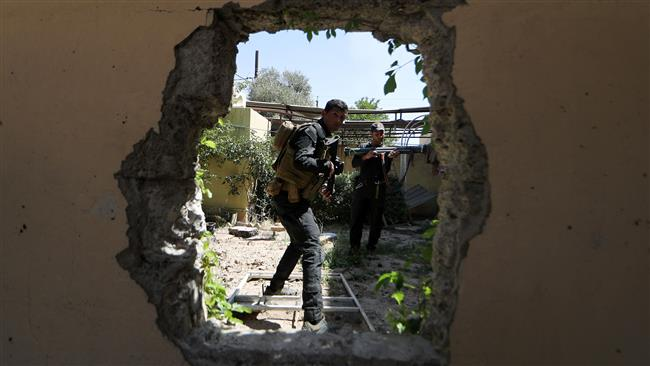 Photo of Iraqi forces storm Mosul's Old City in 'last chapter' operation