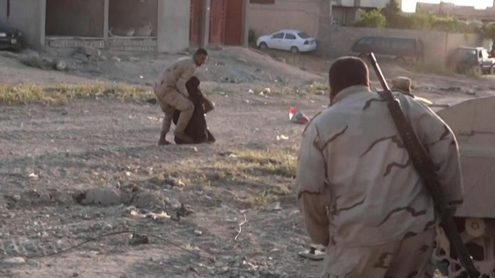 Photo of Video- Old woman fleeing ISIS saved by a brave Iraqi soldier risking his life