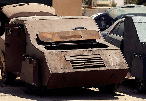 Photo of Photos- ISIL's Deadly Vehicles Go on Show in Mosul after Terrorists' Defeat