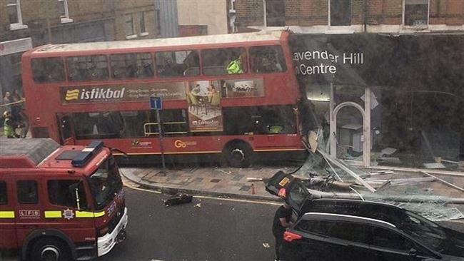 Photo of Double-decker bus smashes into store in London