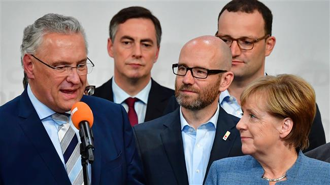 Photo of Merkel faces bumpy road ahead in building coalition govt.