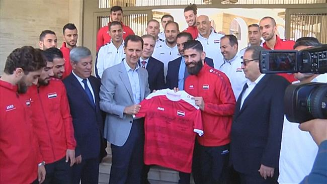 Photo of Assad meets Syrian soccer team, including former dissidents
