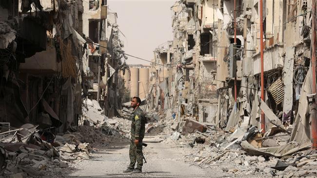Photo of Daesh terrorists quit Raqqah under US-backed deal
