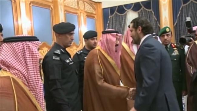 Photo of Grim Hariri stands in queue to salute zionist Saudi king