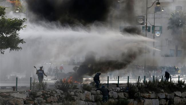 Photo of Palestinian protesters clash with occupation forces in West Bank, Gaza + Video