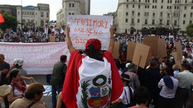 Photo of 1000s protest pardon of former dictator Alberto Fujimori in Peru