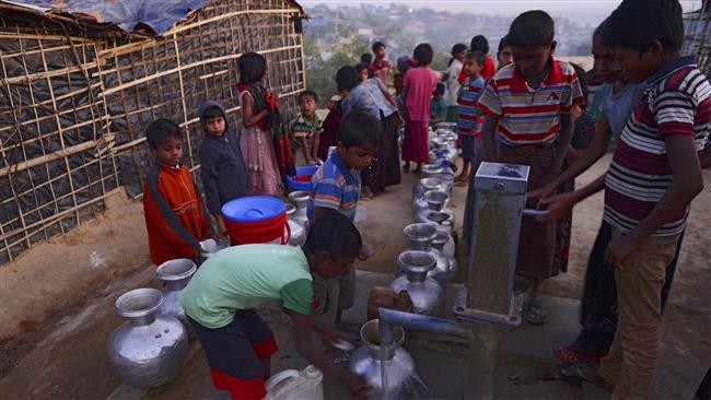 Photo of Bangladesh tells Rohingya refugees they may lose food ration if stay
