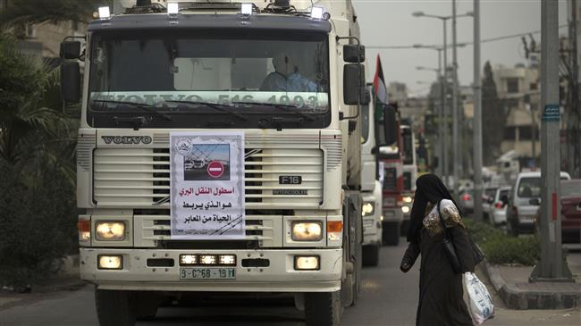 Photo of Gaza's truck drivers hold protest against zionist siege