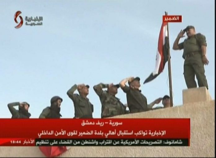 Photo of Syrian army raises flag of Syria over Dumayr