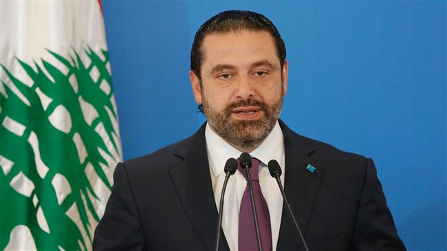 Photo of Lebanon's disgraced PM Hariri acknowledges defeat, loses third of parliament seats
