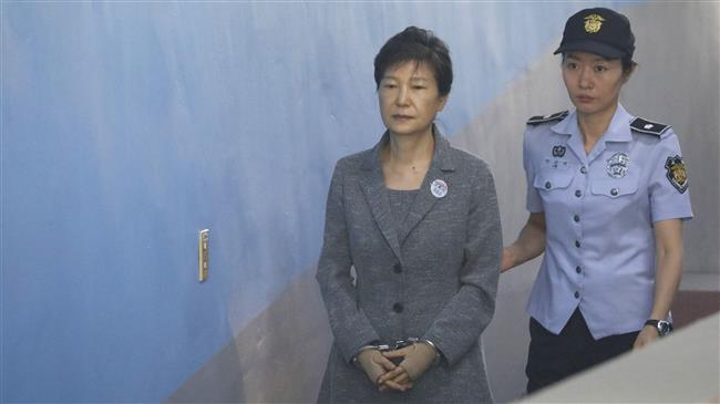 Photo of South Korean court gives ex-president Park 8 more years in jail