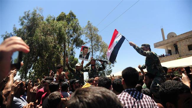 Photo of Syrian army hoists national flag in Dara'a city