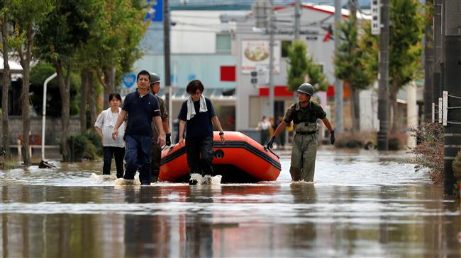 Photo of Japan in 'race against time' to rescue flood victims