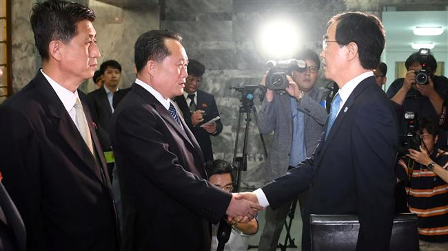 Photo of South, North Korean officials discuss possible third leaders' summit