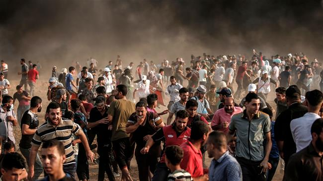 Photo of Terrorist israeli forces attack Palestinian protesters in Gaza, injure 240