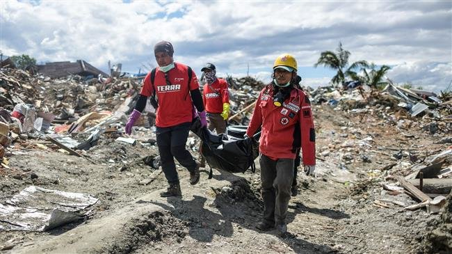 Photo of Indonesia finds more bodies as death toll from quake nears 2,000