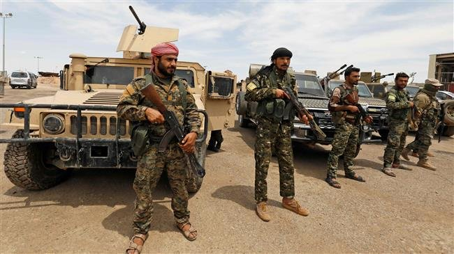 Photo of US-backed militants in Syria say holding 900 Daesh militants