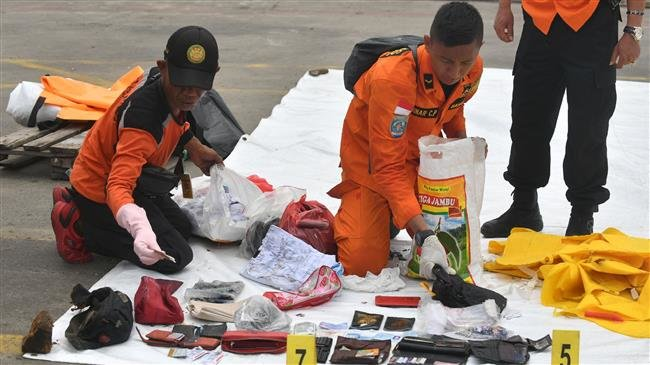Photo of More body parts retrieved from Indonesia jet crash site