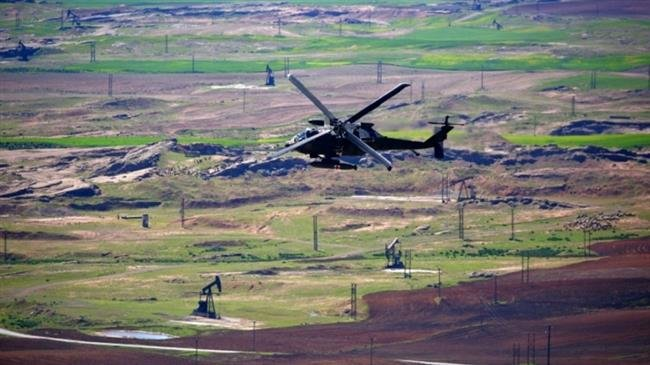 Photo of US copters evacuate Daesh militants from Syria's Dayr al-Zawr