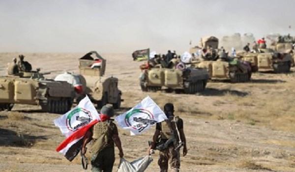 Photo of Hashd Al-Shaabi Blocks US Attempts to Capture Military Base in Al-Anbar