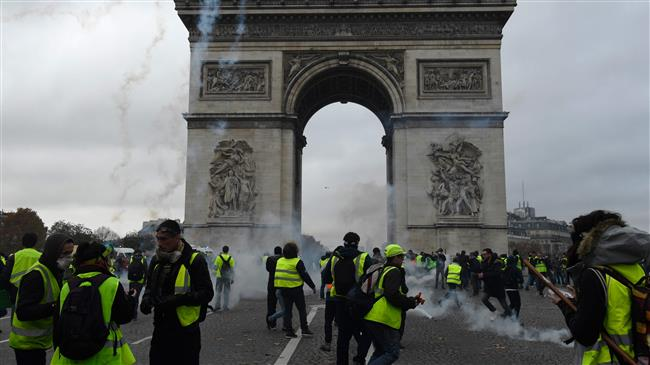 Photo of Protests on Champs Elysees rages through the night