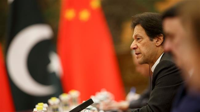 Photo of China vows to support Pakistan as Khan visits Beijing