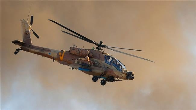 Photo of Zionist regime's military helicopters strike Hamas posts south of Gaza Strip
