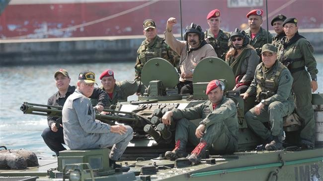 Photo of Maduro inspects army preparations in show of power to US-backed opposition
