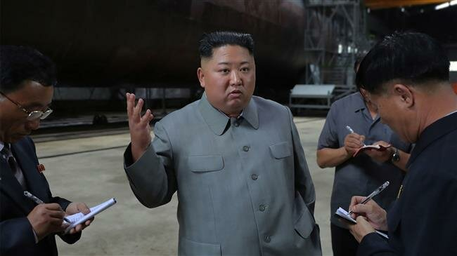 Photo of North Korea's Kim warns South against 'double-dealing'