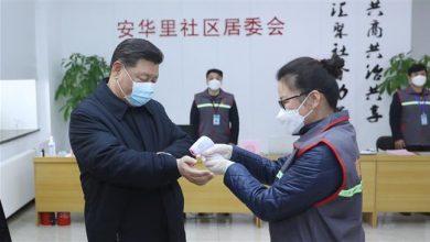 Photo of China virus death toll passes 1,000; president makes rare visit to coronavirus patients