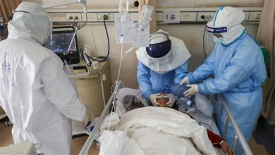 Photo of China reports rise in new virus cases as death toll nears 1,800