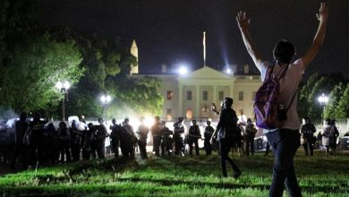 Photo of Protesters circle White House grounds as curfews go into effect nationwide